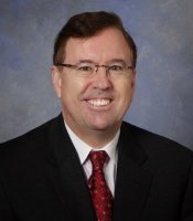 a headshot of Mark Szyperski, president and ceo of on your mark transportation