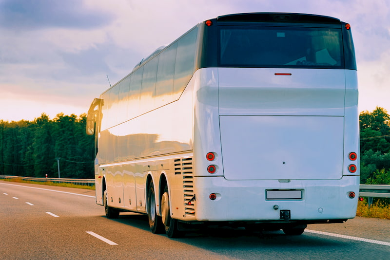 charter bus driving on highway