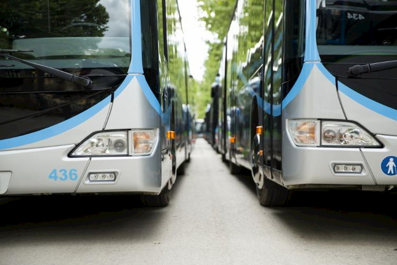 two charter buses parked next to each other